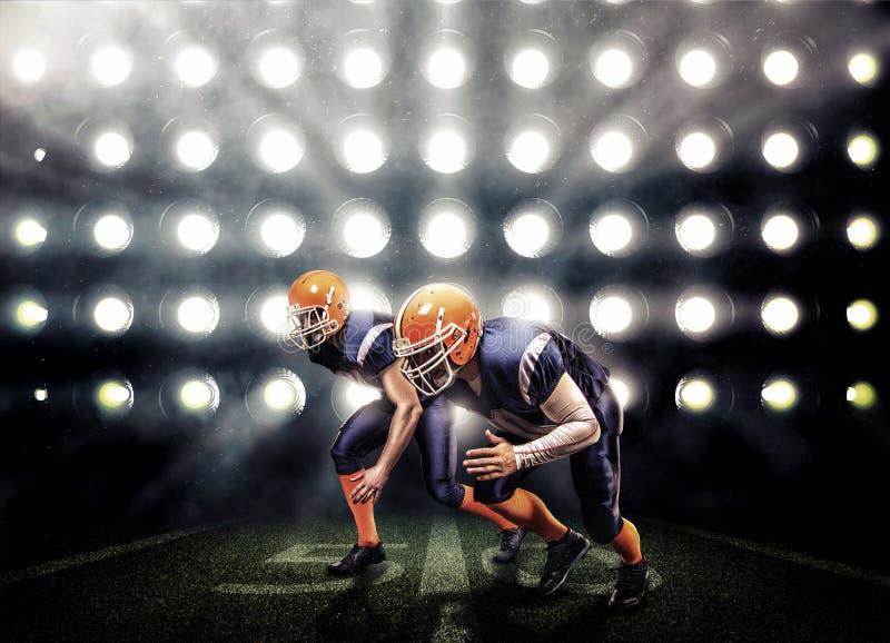 Giocatore di football americano nell'azione fotografia stock
