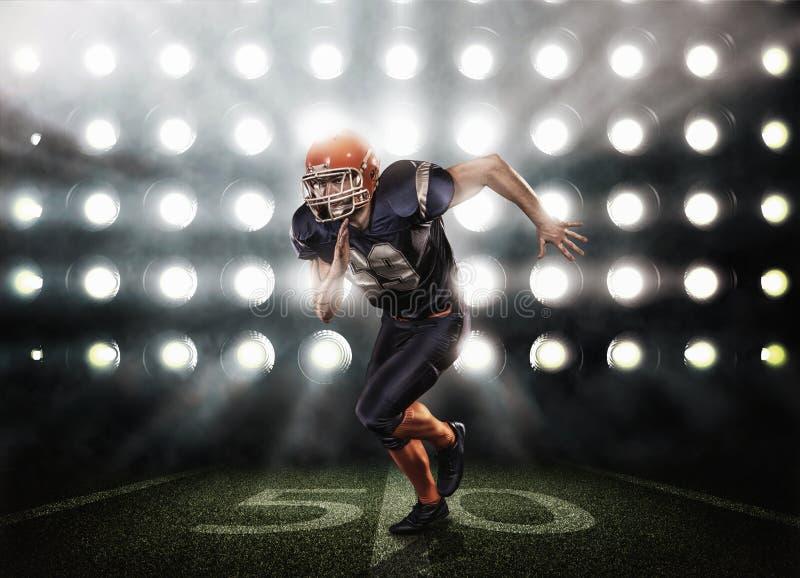 Giocatore di football americano nell'azione immagine stock libera da diritti