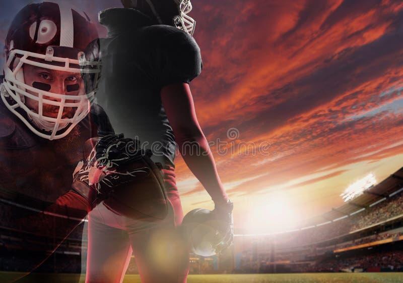 Giocatore di football americano pronto ad iniziare gioco allo stadio fotografia stock