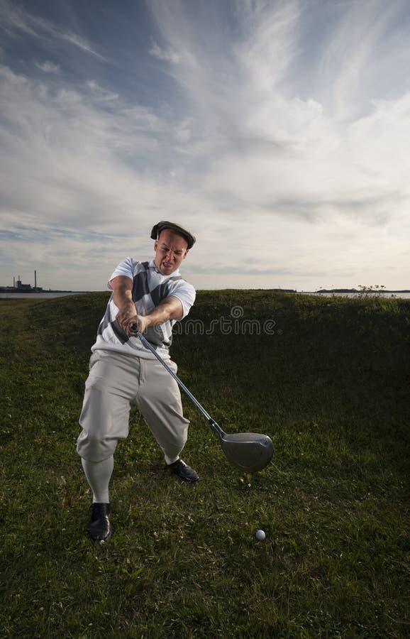Giocatore di golf che manca la sfera. immagine stock