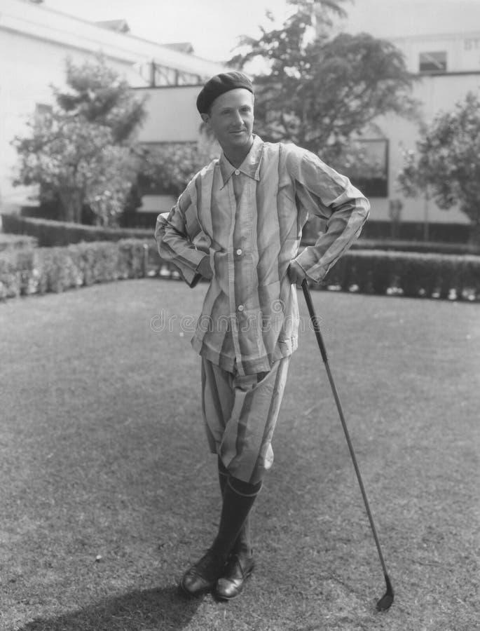 Giocatore di golf di primo mattino fotografia stock