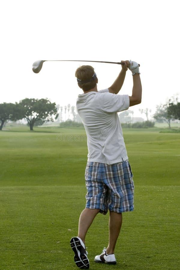 Giocatore di golf di primo mattino fotografia stock libera da diritti