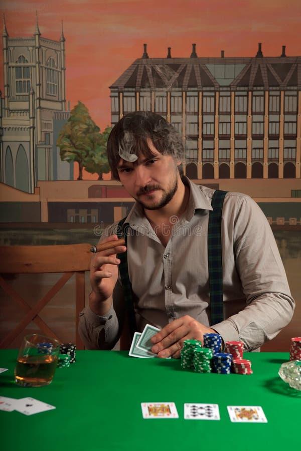 Giocatore di mazza con le schede. fotografia stock libera da diritti