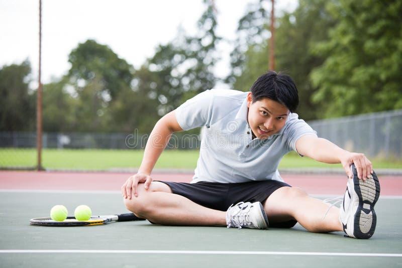 Giocatore di tennis asiatico immagine stock