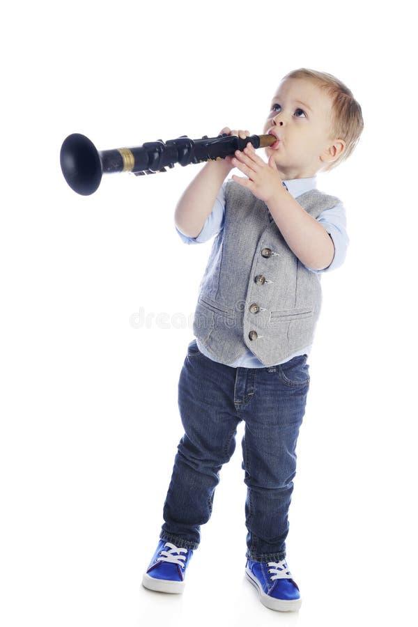 Giocatore minuscolo del clarinetto immagine stock