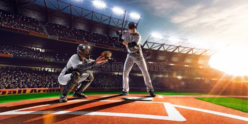 Giocatori di baseball professionisti sulla grande arena fotografia stock libera da diritti