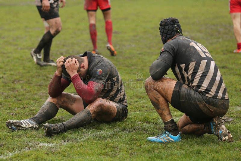 Giocatori di rugby deludenti immagini stock libere da diritti