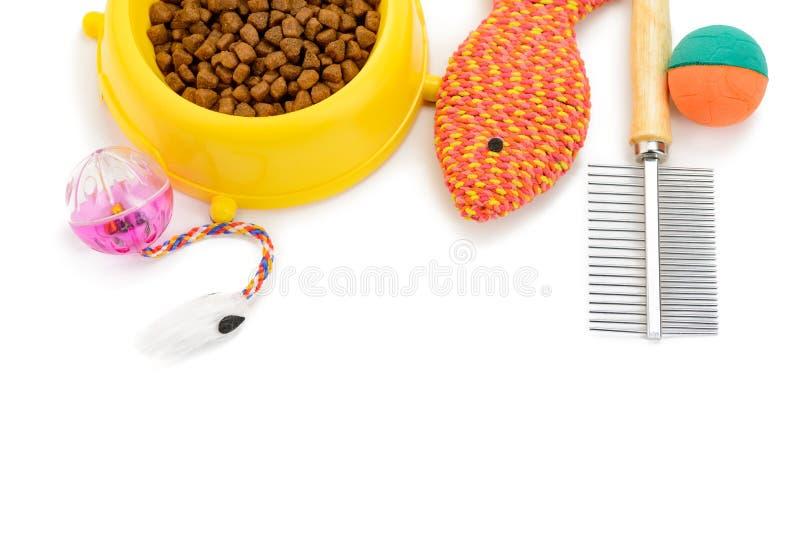 Giocattoli, alimento e spazzola immagini stock