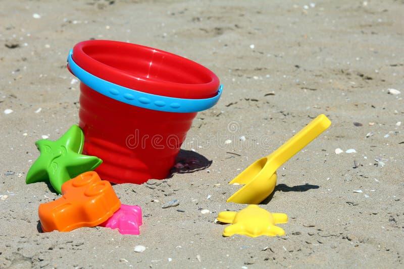 Giocattoli del contenitore di sabbia immagini stock libere da diritti