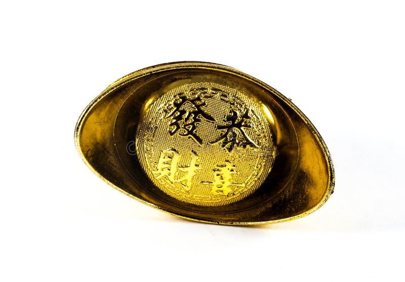Giocattolo cinese del lingotto dell'oro isolato su bianco fotografia stock