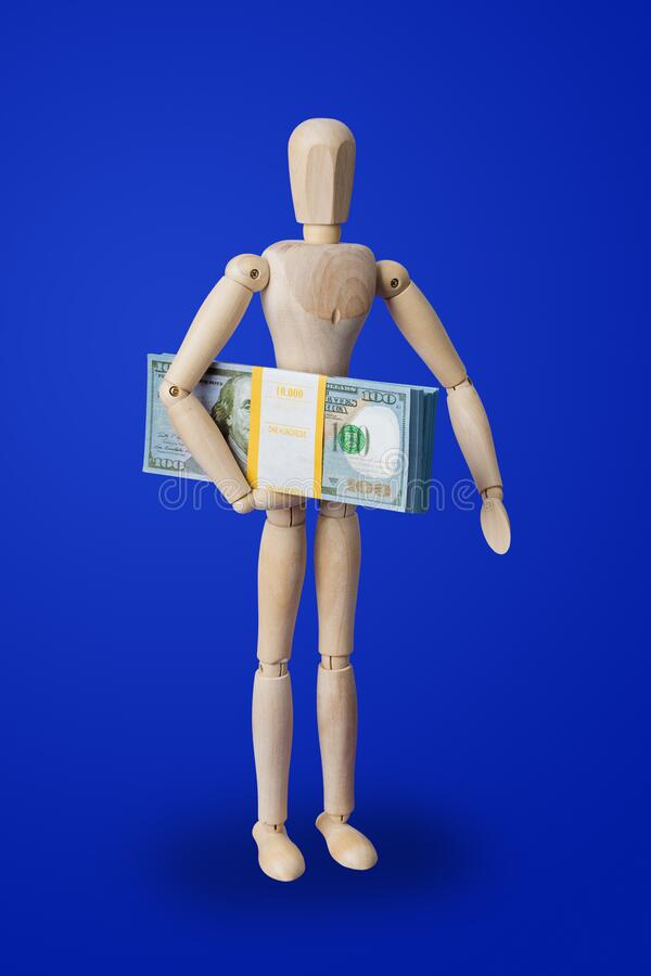 Giocattolo di legno con i soldi in blu immagini stock libere da diritti
