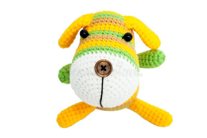 Giocattolo tricottato - cane di seduta a strisce fotografia stock