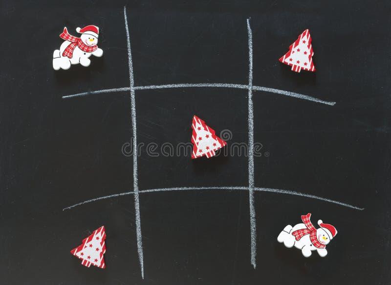 Gioco da tavolo del dito del piede di tac di tic di Natale fotografia stock libera da diritti