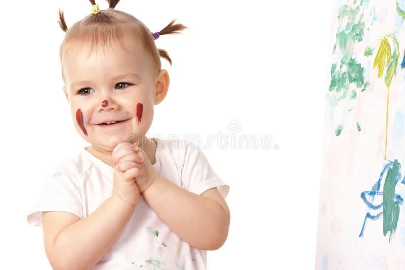 Gioco della bambina con le vernici immagini stock libere da diritti