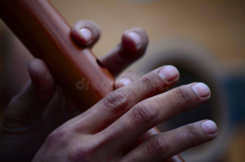 Gioco della flauto di legno immagini stock libere da diritti