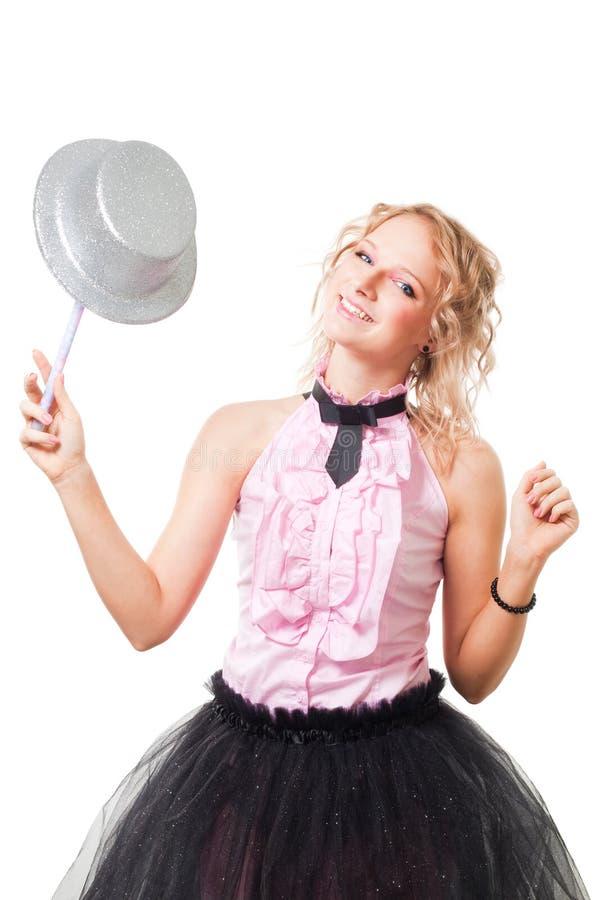 Gioco magitian biondo della donna con il cappello e la bacchetta di magia immagini stock