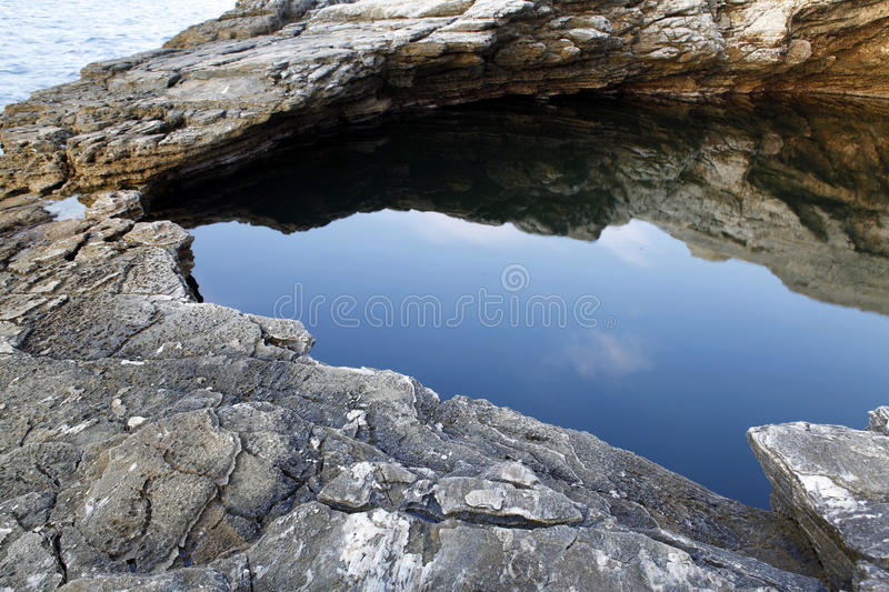 Giola - natural pool in Thassos island, Greece. Beautiful details and reflexions stock image