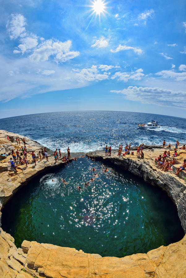 GIOLA, THASSOS, GREECE - AUGUST 2015: Tourists bathing in the Giola. Giola is a natural pool in Thassos island, August 2015, Gree royalty free stock image