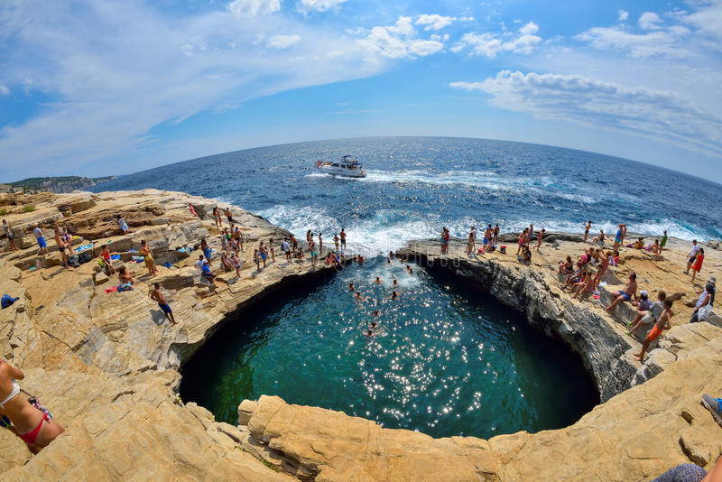GIOLA, THASSOS, GREECE - AUGUST 2015: Tourists bathing in the Giola. Giola is a natural pool in Thassos island, August 2015, Gree stock image
