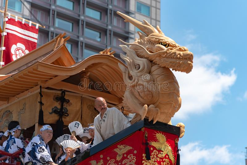 Gion Matsuri Festival, the most famous festivals in Japan. Participants in traditional clothing pulling a highly decorated huge float in the parade royalty free stock photography