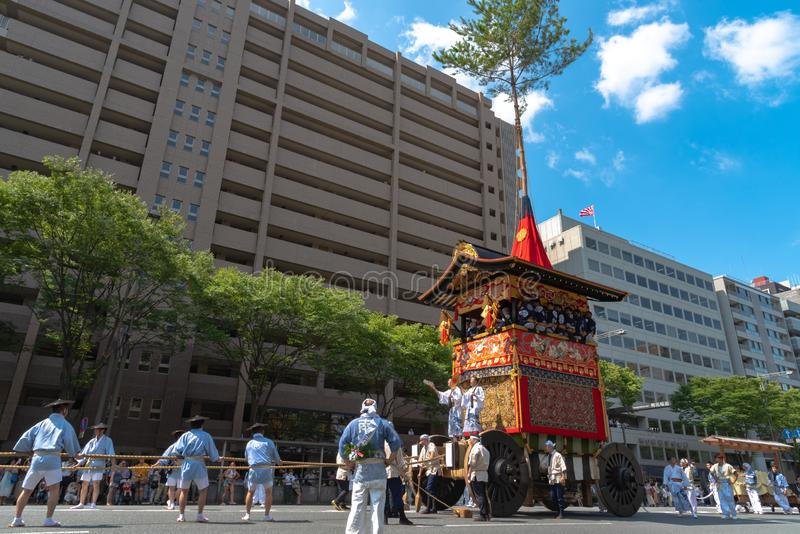 Gion Matsuri Festival, the most famous festivals in Japan. Participants in traditional clothing pulling a highly decorated huge float in the parade stock images