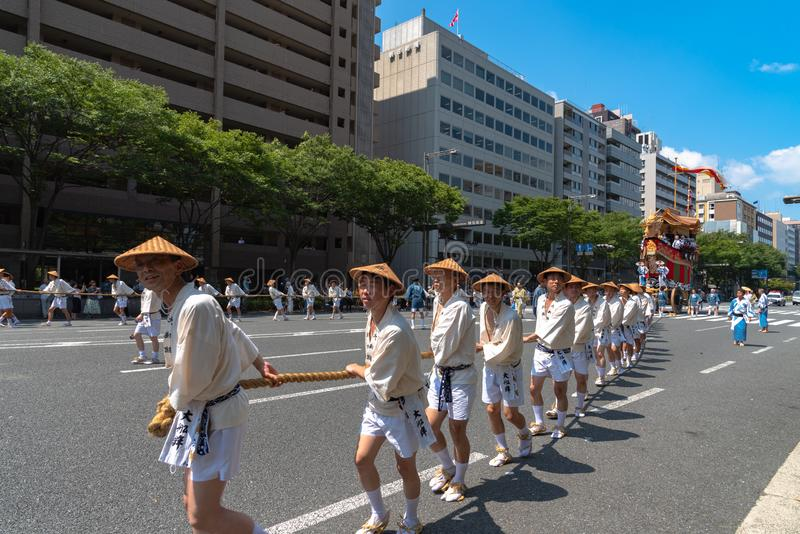 Gion Matsuri Festival, the most famous festivals in Japan. Participants in traditional clothing pulling a highly decorated huge float in the parade royalty free stock photo