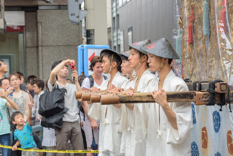 Gion Matsuri in Kyoto, Japan – July 17, 2016. Kyoto, Japan – July 17, 2016: Japanese men in traditional clothing at in Gion Matsuri parade stock images