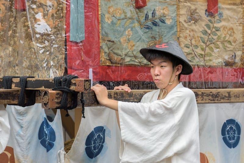 Gion Matsuri in Kyoto, Japan – July 17, 2016. Kyoto, Japan – July 17, 2016: Japanese men in traditional clothing at in Gion Matsuri parade royalty free stock photography