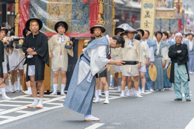 Gion Matsuri in Kyoto, Japan – July 17, 2016. Kyoto, Japan – July 17, 2016: Japanese men in traditional clothing at in Gion Matsuri parade royalty free stock image