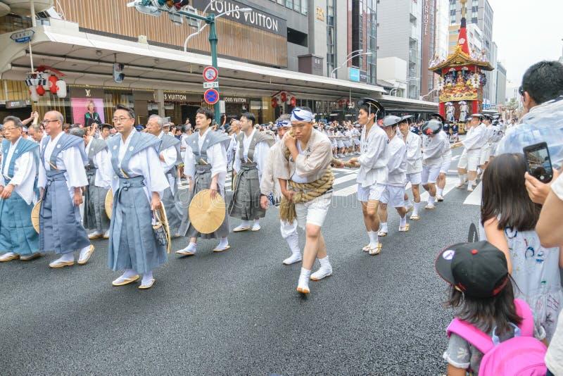 Gion Matsuri in Kyoto, Japan – July 17, 2016. Kyoto, Japan – July 17, 2016: Japanese men in traditional clothing at in Gion Matsuri parade stock photography