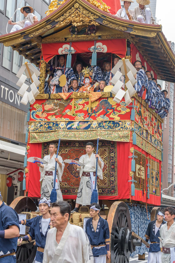Gion Matsuri in Kyoto, Japan – July 17, 2016. Kyoto, Japan – July 17, 2016: Japanese men in traditional clothing at in Gion Matsuri parade royalty free stock images