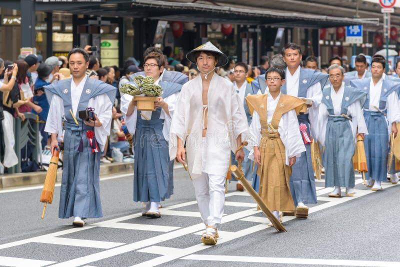 Gion Matsuri in Kyoto, Japan – July 17, 2016. Kyoto, Japan – July 17, 2016: Japanese men in traditional clothing at in Gion Matsuri parade stock photos
