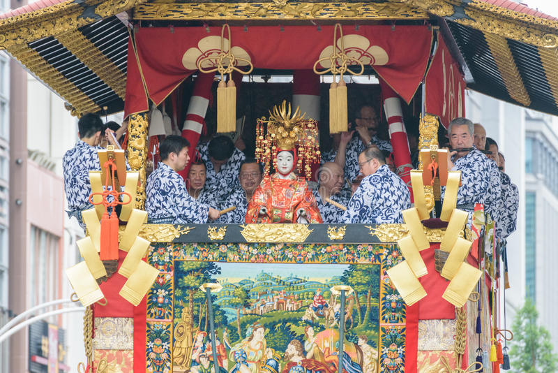 Gion Matsuri in Kyoto, Japan – July 17, 2016. Kyoto, Japan – July 17, 2016: Japanese men in traditional clothing at in Gion Matsuri parade stock photo