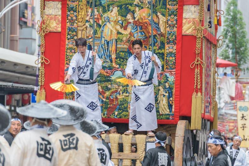 Gion Matsuri in Kyoto, Japan – July 17, 2016. Kyoto, Japan – July 17, 2016: Japanese men in traditional clothing at in Gion Matsuri parade royalty free stock photo