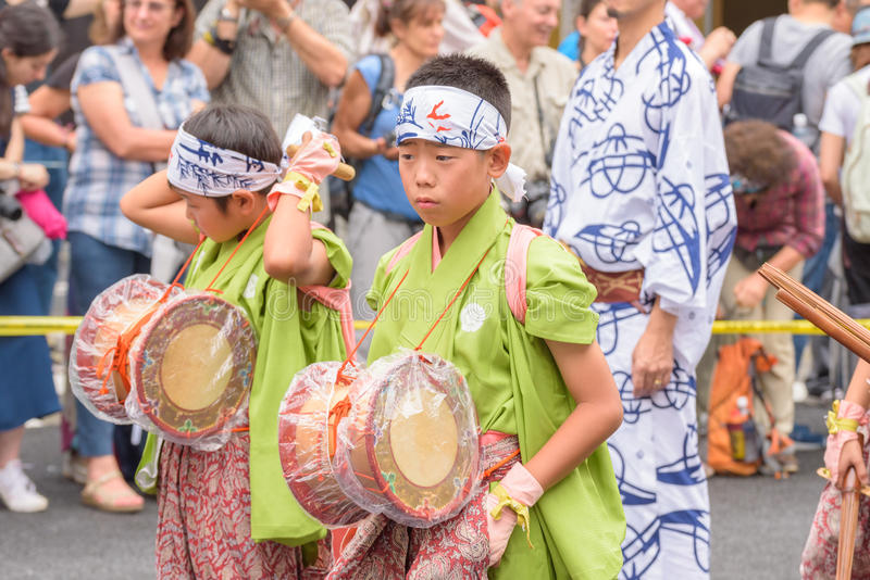 Gion Matsuri in Kyoto, Japan – July 17, 2016. Kyoto, Japan – July 17, 2016: Japanese men in traditional clothing at in Gion Matsuri parade royalty free stock photos