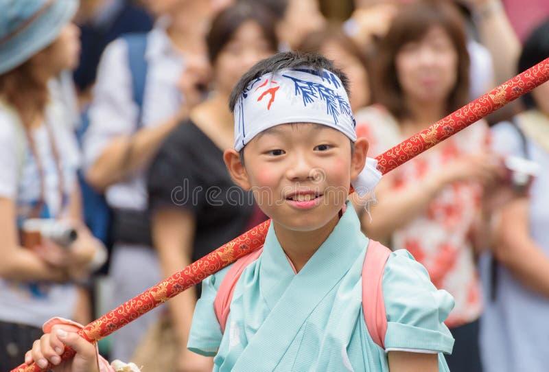 Gion Matsuri in Kyoto, Japan – July 17, 2016. Kyoto, Japan – July 17, 2016: Japanese men in traditional clothing at in Gion Matsuri parade stock image