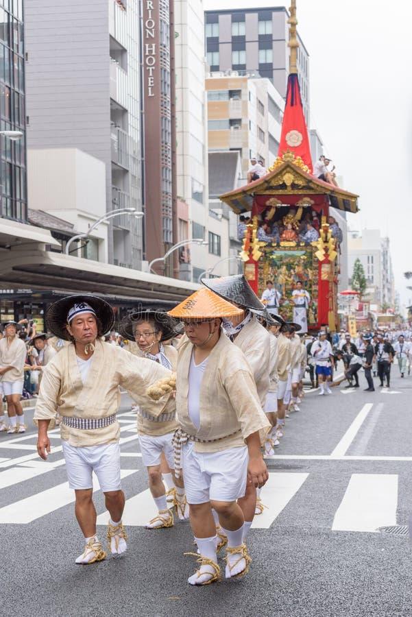 Gion Matsuri in Kyoto, Japan - July 17, 2016. Kyoto, Japan - July 17, 2016: Japanese men in traditional clothing at in Gion Matsuri parade stock photo