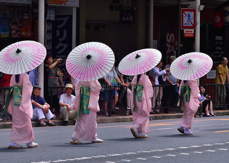 Gion matsuri parede in summer, Kyoto Japan. Parade of kimono girls with parasols in an event of Gion festival in summer. Kyoto Japan royalty free stock images