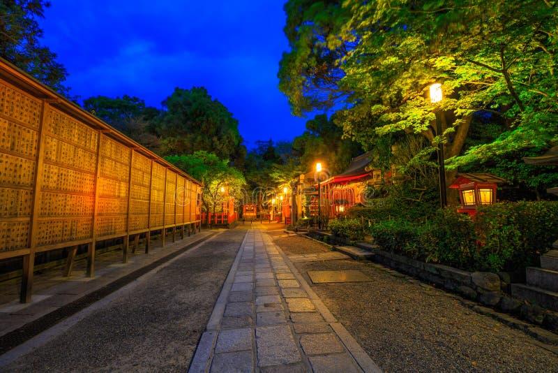 Gion Shrine at dusk. Kyoto, Japan - April 25, 2017: Illuminated path at dusk from Yasaka Shrine to the Gion weeping cherry tree in Maruyama Park. Gion Shrine is royalty free stock photos