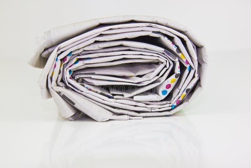 Giornale rotolato - sulla vista di conclusione fotografia stock libera da diritti
