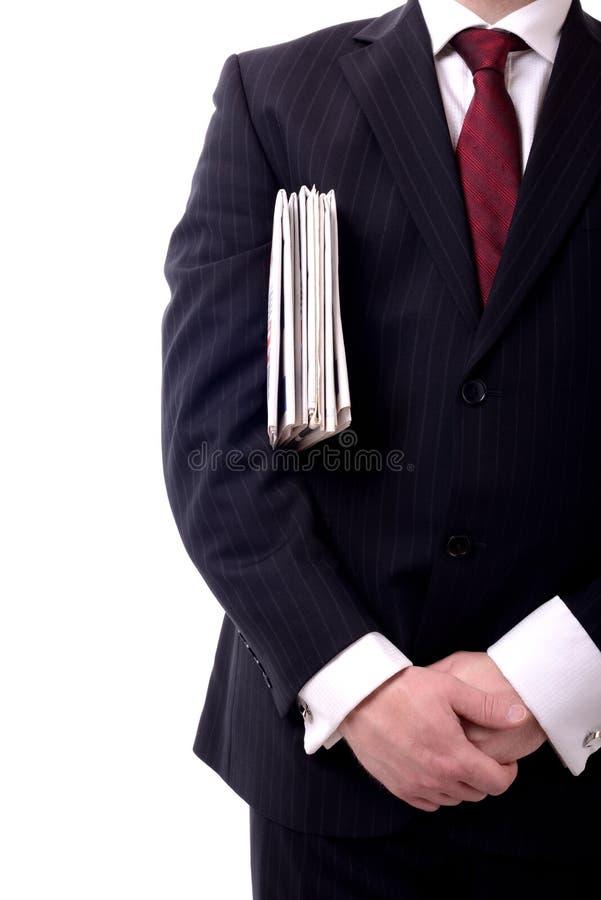 Giornali dell'uomo d'affari fotografia stock