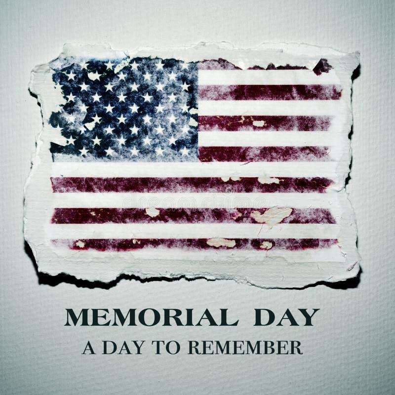 Giorno dei Caduti del testo e della bandiera americana fotografia stock