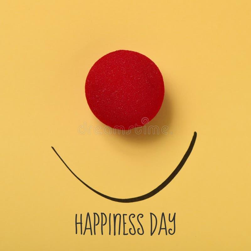 Giorno divertente di felicità del testo e del fronte fotografia stock libera da diritti