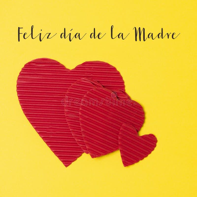 Giorno felice di madri del testo e dei cuori nello Spagnolo immagine stock libera da diritti
