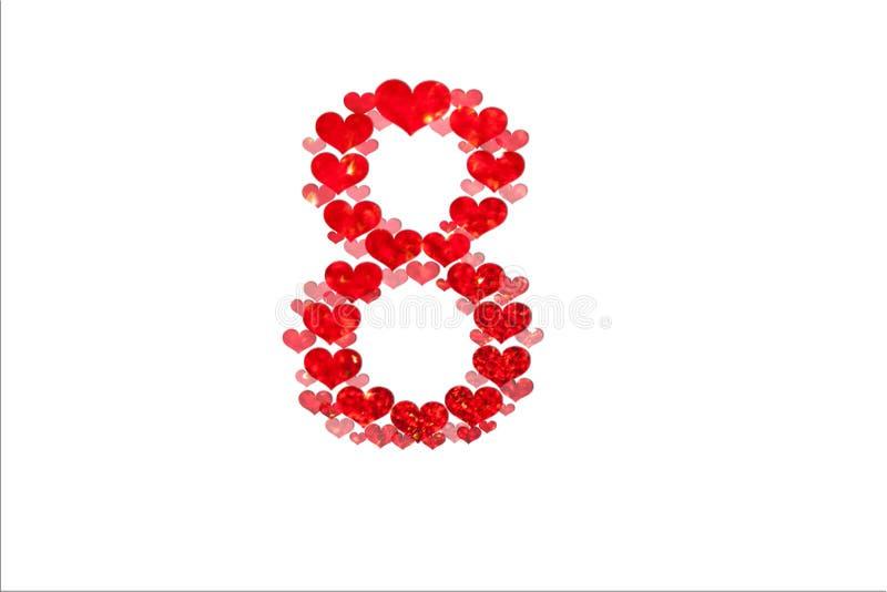 Giorno internazionale felice delle donne s celebrare l'8 marzo, CARTA di congratulazioni numero 8 fatto dai cuori rossi su fondo  fotografia stock