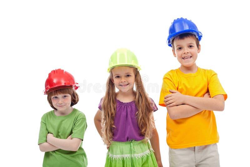 Giorno professionale di consiglio - bambini con gli elmetti protettivi fotografia stock libera da diritti