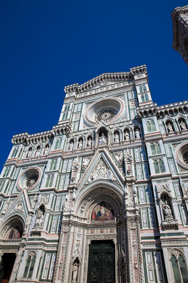 Giotto Campanile and Florence Cathedral consecrated in 1436 against a beautiful blue sky stock photos