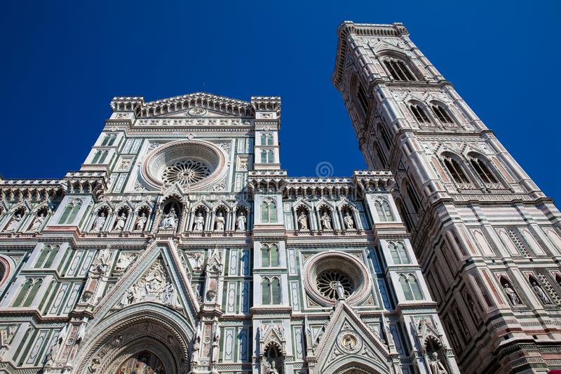 Giotto Campanile and Florence Cathedral consecrated in 1436 against a beautiful blue sky stock photography