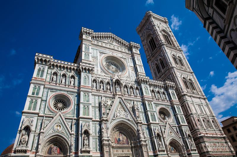 Giotto Campanile and Florence Cathedral consecrated in 1436 against a beautiful blue sky stock photo