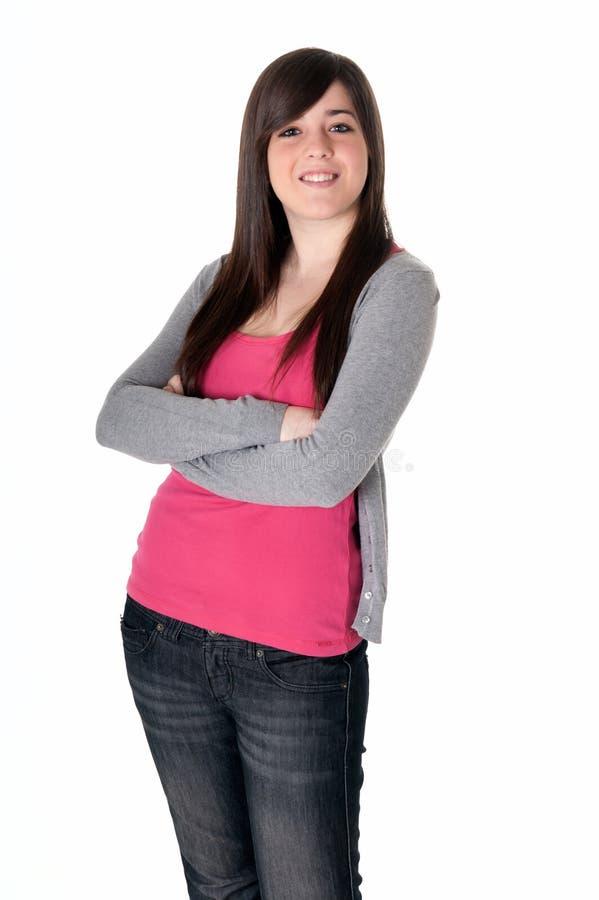 Giovane allegro femminile con le braccia ha attraversato isolato fotografia stock